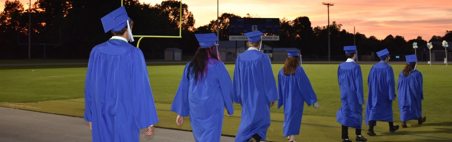 Students walking on the football field for 2020 Graduation